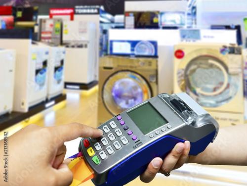 Credit card payment at washing machine Retail shop  - Buy
