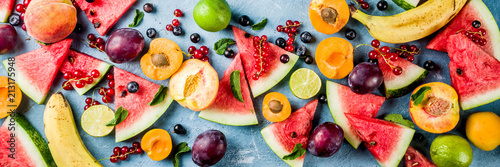 Foto auf AluDibond Fruchte Summer vitamin food concept, various fruit and berries watermelon peach mint plum apricots blueberry currant, creative flat lay on light blue background top view copy space