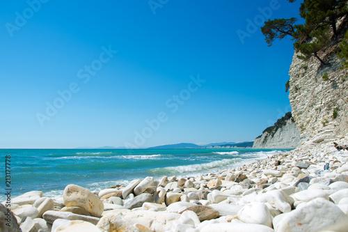 Tuinposter Kust white stones on the sea coast