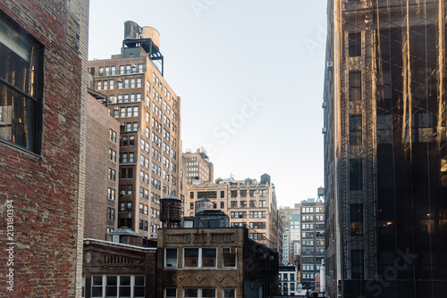 Cityscape of New York with old buildings and water towers