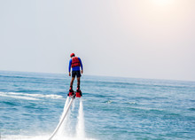 Man Posing At New Flyboard At Sea. Positive Human Emotions, Feelings, Vacations And Enjoying Summer.