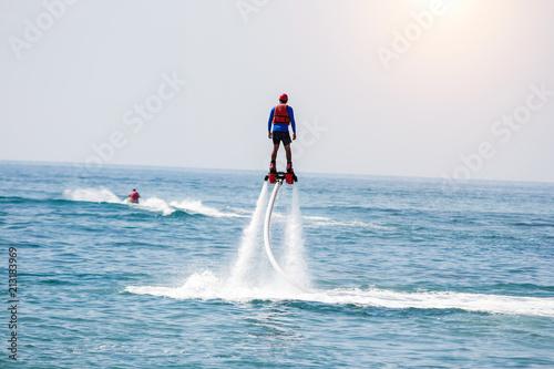 Garden Poster Water Motor sports Man posing at new flyboard at sea. Positive human emotions, feelings, vacations and enjoying summer.