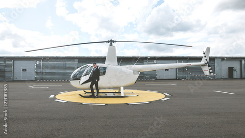 Fotografia Portrait of young adult businessman executive standing near a private charter he