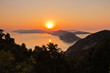 Aerial sunrise behind Alonisos island from the top of a hill in Skopelos, Greece