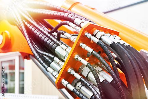 Fotografie, Obraz Hoses of hydraulic machine