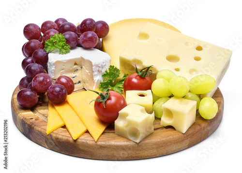 Delicious cheese plate with various sorts of cheese like Emmentaler, gouda and brie. Gourmet cheese on a wooden cutting board, isolated on white background.