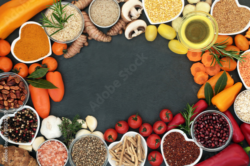Foto op Aluminium Assortiment Health food background border with fruit, vegetables, grains, pulses, herbs, spices, seeds, nuts, himalayan salt and olive oil. Food high in antioxidants, smart carbohydrates, vitamins and minerals.