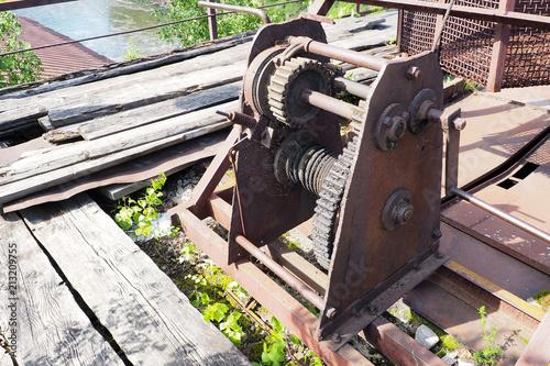 Deurstickers Dam closing mechanism of old dam, last century