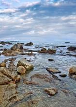 Tranquil Seashore With Erraticl Shaped Rocks, Sanya, Hainan Island, China