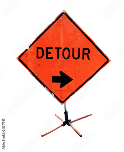 Fotografie, Obraz  Battered DETOUR sign with arrow on construction tripod. Isolated.
