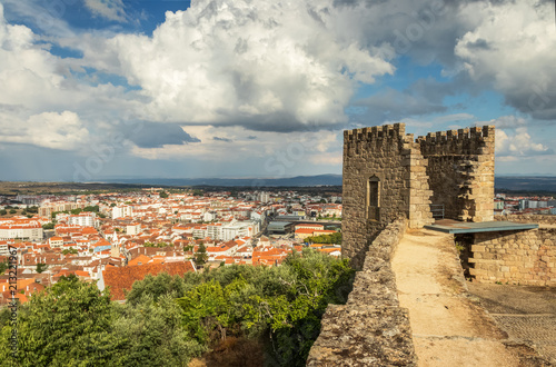 Obraz na plátně Castle tower of Castelo Branco, Portugal, with the city in the background and a sky with large clouds