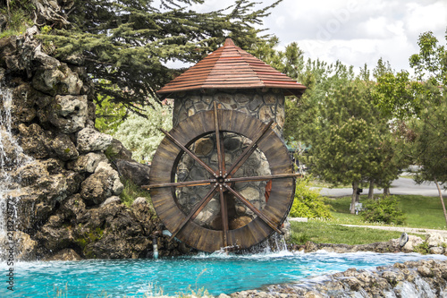 Photo Public resting place, Working watermill wheel with falling water