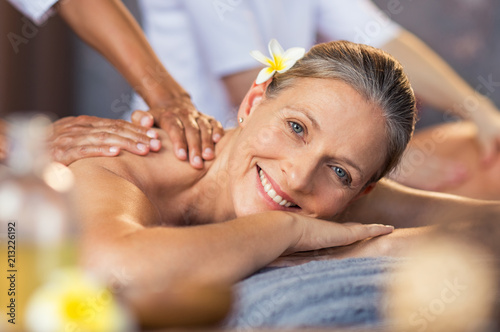 Woman getting oil massage at spa