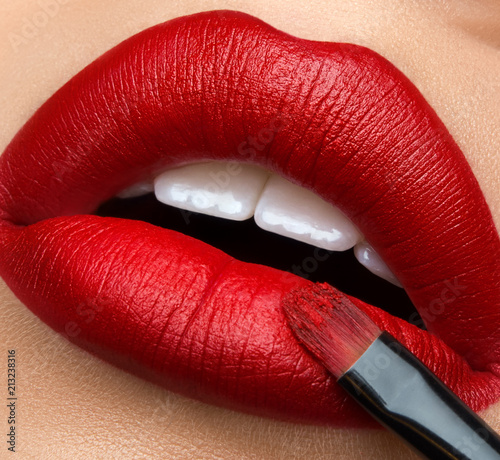 Cuadros en Lienzo Macro and close-up creative make-up theme: beautiful female lips with red lipsti