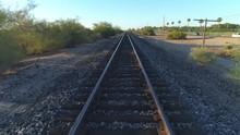 4K Pan Down Of Desert Train Tracks At Sunrise