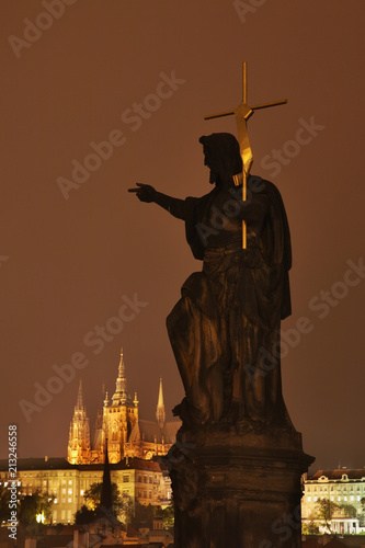 Foto op Plexiglas Historisch mon. Sculpture of John the Baptist at Charles bridge in Prague. Czech Republic