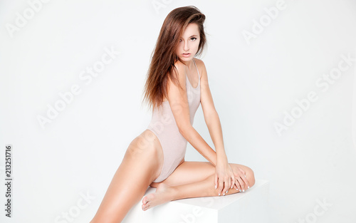 Fototapety, obrazy: Pure natural beauty of young pretty woman with slim perfect body posing over white background. Fitness and health concept.