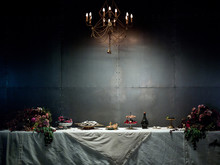 Long Table With Food And Flowers
