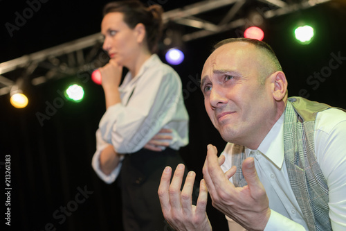 two actors playing the role on stage