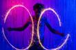 Leinwandbild Motiv Man drawing circles with sparklers