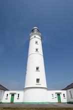 A Lighthouse On A Beautiful Co...