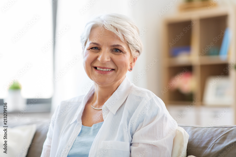 Fototapeta emotion, age and people concept - portrait of happy senior woman laughing