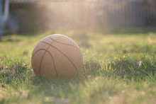 Old Basketball On Grass Background