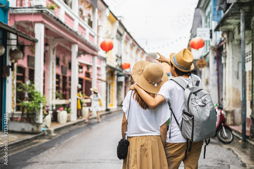 Cadres-photo bureau Lieu connus d Asie Young couple traveler walking at Phuket old town in Thailand
