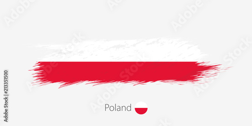 Flag of Poland, grunge abstract brush stroke on gray background.
