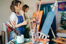 Beautifull Women On Drawing Workshop. Painting.