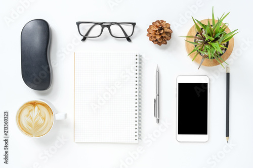 White Hipster Office Desk Table With Supplies. Top View, Flat Lay.