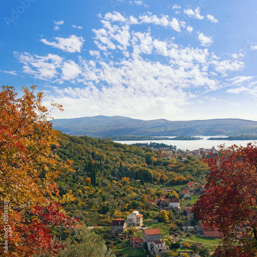 Tuinposter Blauwe hemel Colorful autumn landscape. Montenegro, view of Tivat city and Lustica peninsula from the slope of the mountain