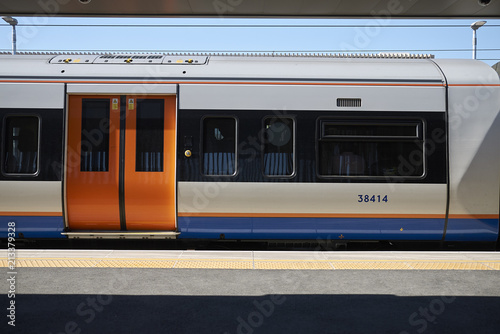 Fototapeta London, United Kingdom - June 25, 2018 : Overground train in Hackney