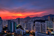 Kowloon Residential Building and Urban Skyscrapers Under Mountains Lion Rock Summer Sunset Landscape with Dramatic Sky