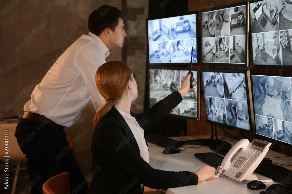 Fototapeta Security guards working in surveillance room