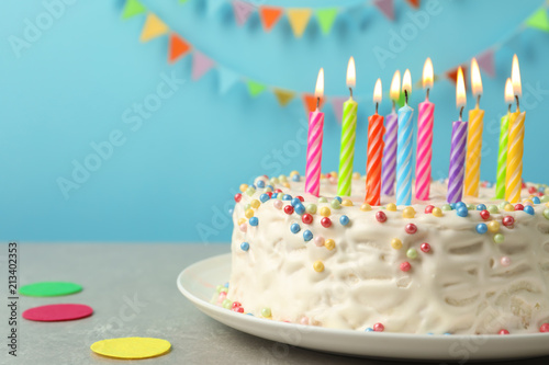 Delicious Birthday Cake With Burning Candles On Table