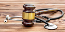 Gavel With Stethoscope On Wood...