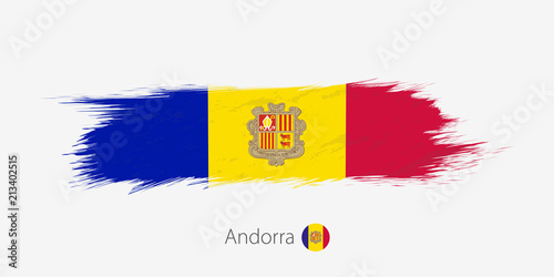 Photo Flag of Andorra, grunge abstract brush stroke on gray background.