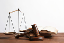 Wooden Gavel, Scales Of Justice And Books On Table. Law Concept