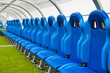 Blue bench or seat or chair of staff coach in the stadium of football