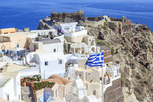 Castillo Area With Castle And Byzantine Ruins And Greek Flag In Oia Village, Santorini Island, Greece
