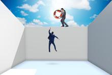 Businessman Saving Colleague With Lifebuoy