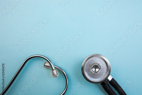 Fototapeta Medical pressure gauge and stethoscope on light blue background, for heart listening, isolated place for text obraz na płótnie