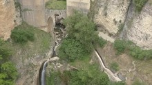 Aerial View Of The Historical Puente Nuevo Bridge, The Newest And Largest Bridge That Span The 120-metre-deep Chasm That Carries The Guadalevín River And Divides The City Of Ronda, In Southern Spain.
