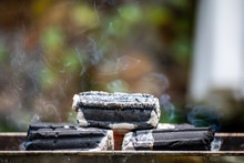 Briquettes Burning On Charcoal...