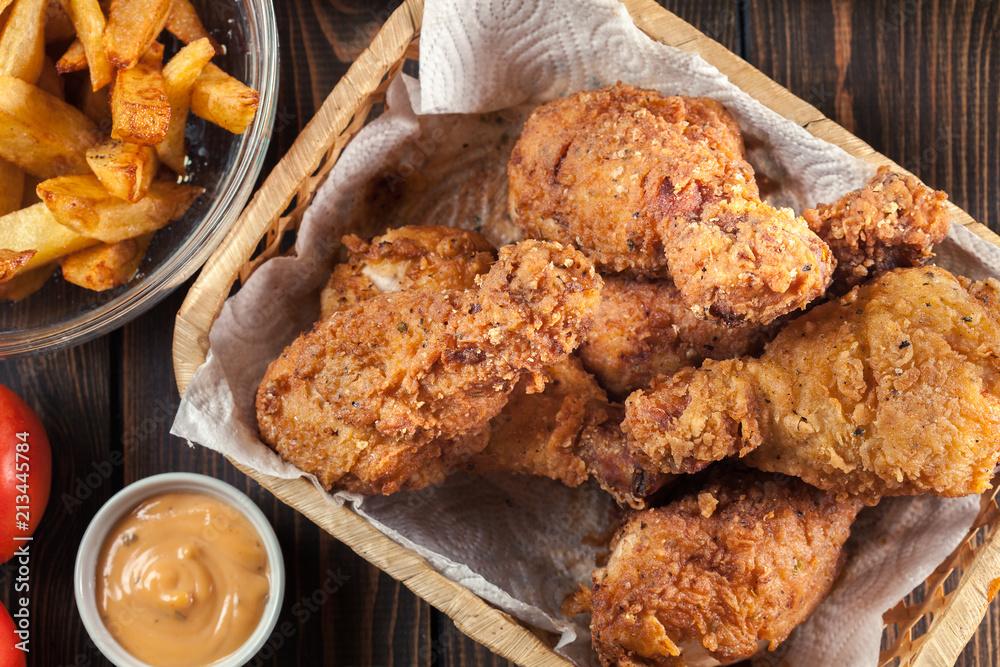 Fototapeta Breaded crispy fried kentucky chicken drumctick