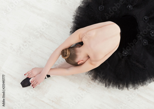 Fotografie, Obraz  Graceful Ballerina stretching, ballet background, top view