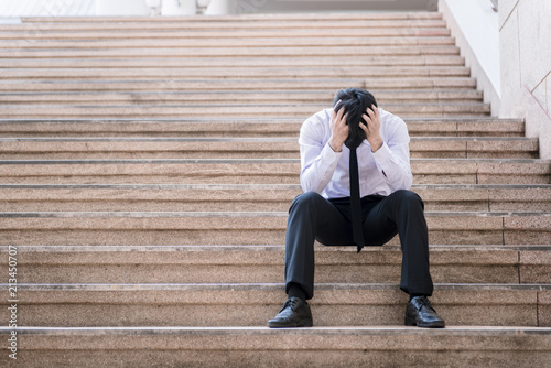 Fotografie, Obraz  Asian businessman professional failed or upset in his job and sitting on staircase