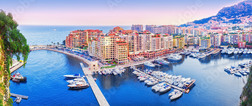 Fototapeta Monaco, Europe. Panoramic scenic view on fashionable apartment district and port Fontvieille in Monaco - small country, symbol of wealth and richness. Beautiful evening skyline of Monaco.  obraz