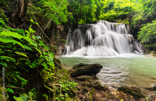 Deurstickers Watervallen Beautiful waterfall in tropical rainforest at Kanchanaburi province, Thailand